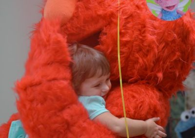 elmo make happy little girl